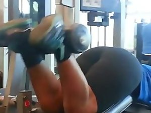 Muscular woman's ass doing a workout