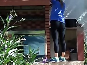 Neighbor strolls out in her black tights