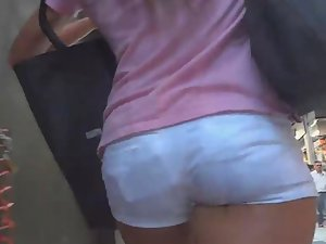 Gorgeous girl in tight white shorts