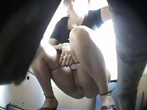 Tasty mature lady spied as she pissed