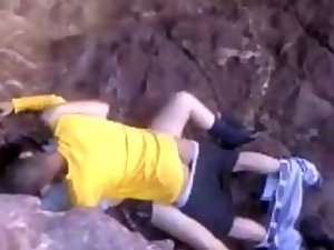 Teens caught fucking by the rocks