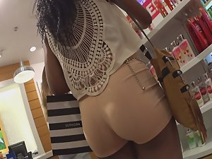 Slim black girl shows ass in booty shorts