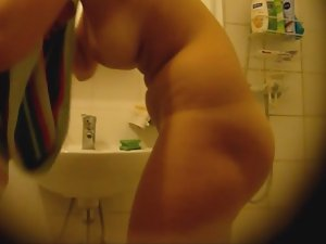 Nude blonde's hot curves in bathroom