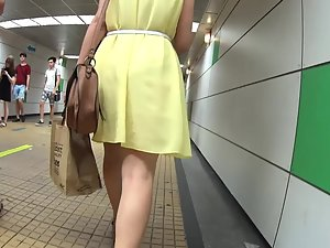 Stalking a woman in yellow dress