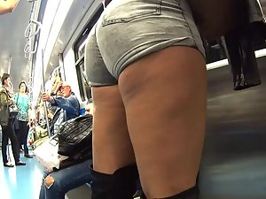Thick girl looks slutty in boots and shorts