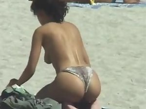 Hunting for topless girls on a beach