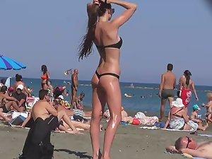 Incredible beach girl in a sexy bikini