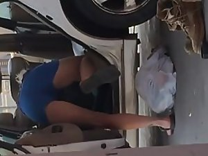 Curvy woman cleaning the car