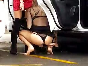 Hot girls pissing on car parking lot
