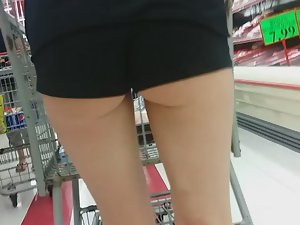 Sexy chick in shorts at supermarket