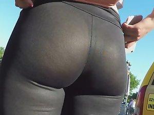 Thong in transparent leggings at crossroads