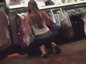Stunning girl gets on her knees in store