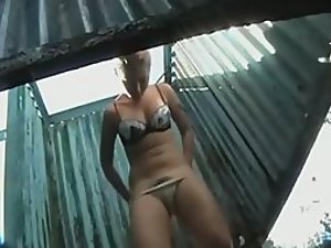 Busty girl changing at a beach cabin