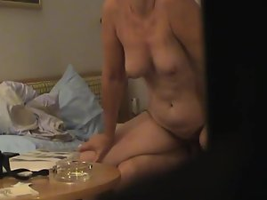 Spying a milf neighbor ride her lover