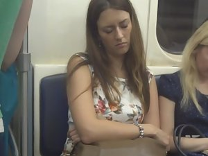 Tired girl in the subway train