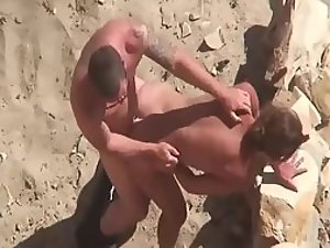 Hard fuck on a sandy beach