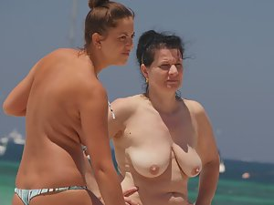 Topless girl on the beach with mother Picture 8