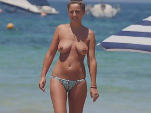 Topless girl on the beach with mother