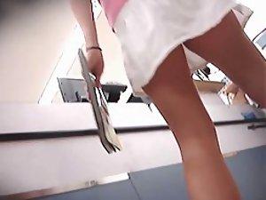 Amazing ass under a white skirt