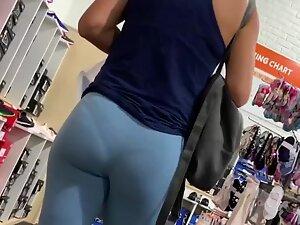 Blueish leggings reveal a thong pantyline