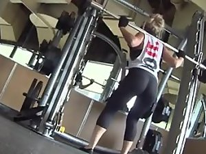 Firm perky asses of girls doing squats