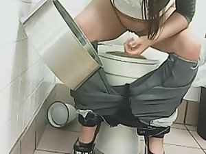 Funny girl in high heels pissed a toilet