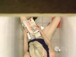 Blonde caught masturbating in a toilet Picture 4