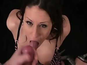 Hot girl with a sweet smile sucks a dick