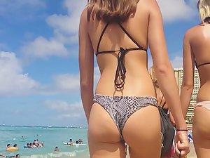 Python pattern on bikini draws attention to hot ass
