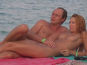 Bald nudist got a perfect woman with him