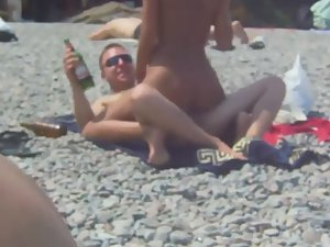 Horny couple filmed fucking on beach
