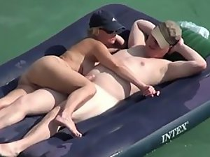 Horny couple in the water on an air mattress