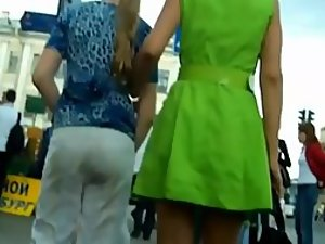 Upskirt of a girl in glowing green skirt