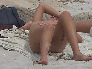 Lesbian girl relaxes on small nudist beach Picture 1