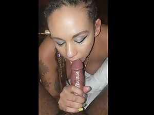Tattooed girl with braided hair gives a good blowjob