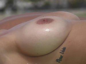 Big topless boobs and underboob tattoo
