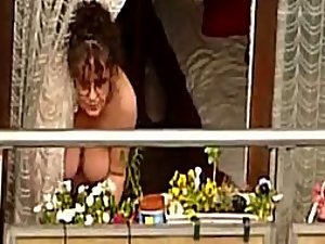 Neighbor woman shows tits on the balcony