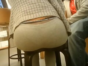 Half thong panty line on a round ass