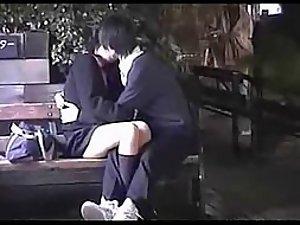 Voyeur watches a teenage couple kissing