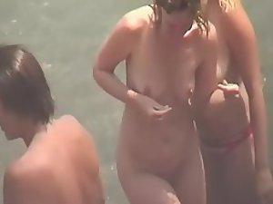 Naked girls enjoying beach festivities