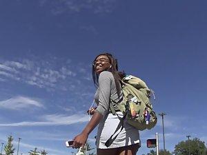 Upskirt of nerdy black girl in short skirt Picture 3