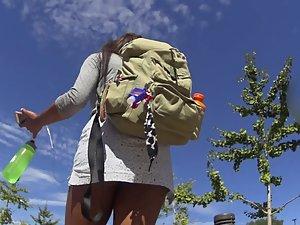 Upskirt of nerdy black girl in short skirt Picture 6