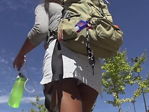 Upskirt of nerdy black girl in short skirt Picture 8