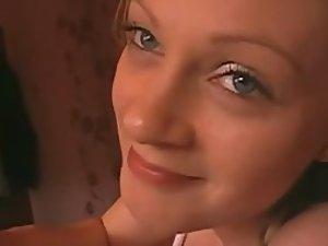 Teenage blonde smiles during anal sex