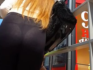 Thong and ass seen through redhead's tights