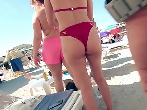 Bent over view of a fun woman in red bikini Picture 3