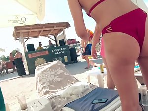 Bent over view of a fun woman in red bikini Picture 4