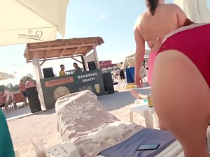Bent over view of a fun woman in red bikini Picture 6