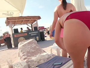 Bent over view of a fun woman in red bikini Picture 7