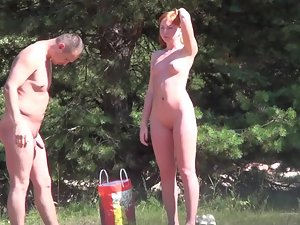 Studying a hot nude redhead before she leaves beach Picture 2